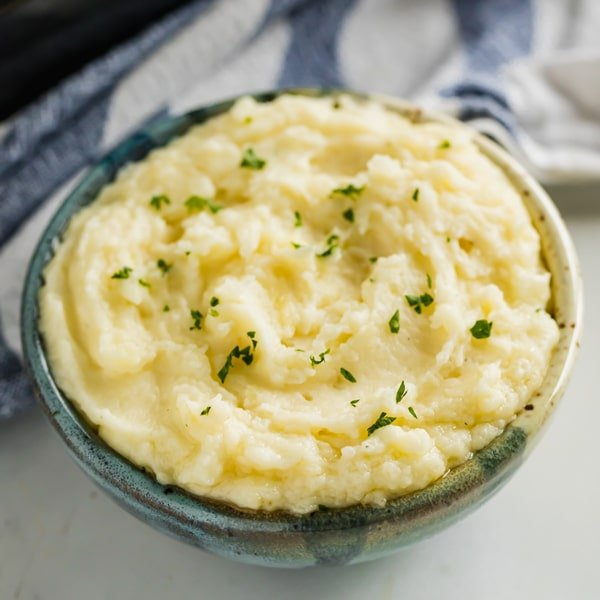 Is it even a holiday dinner without mashed potatoes?! I say, ditch the hassle and make these easy Make Ahead Mashed Potatoes recipe. Made with cream cheese and sour cream, they're creamy, flavorful and totally delicious!