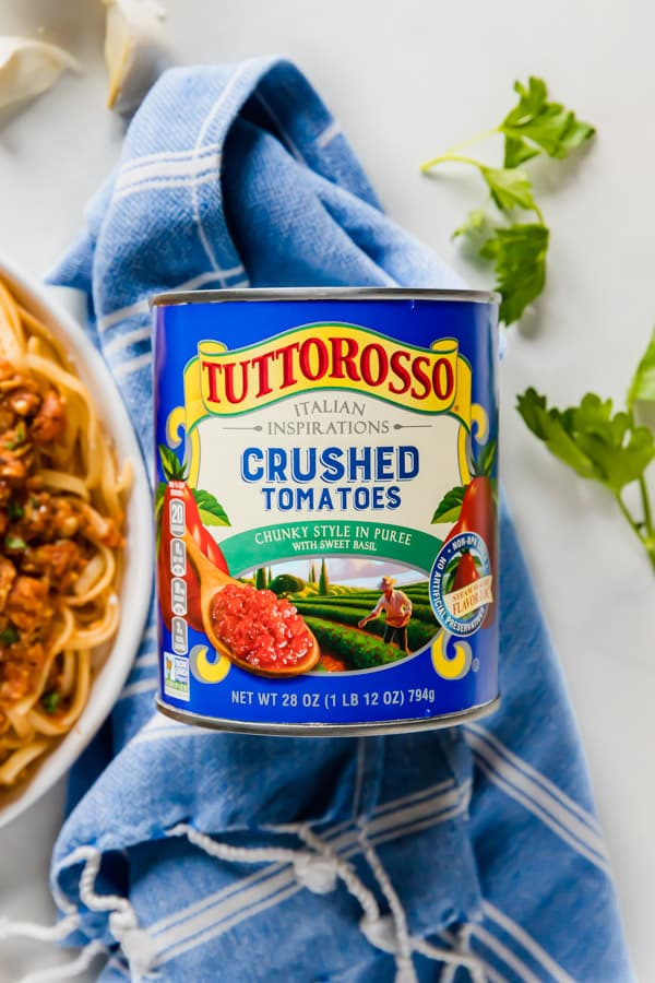 An overhead photos of a tuttorosso can with ingredients around it