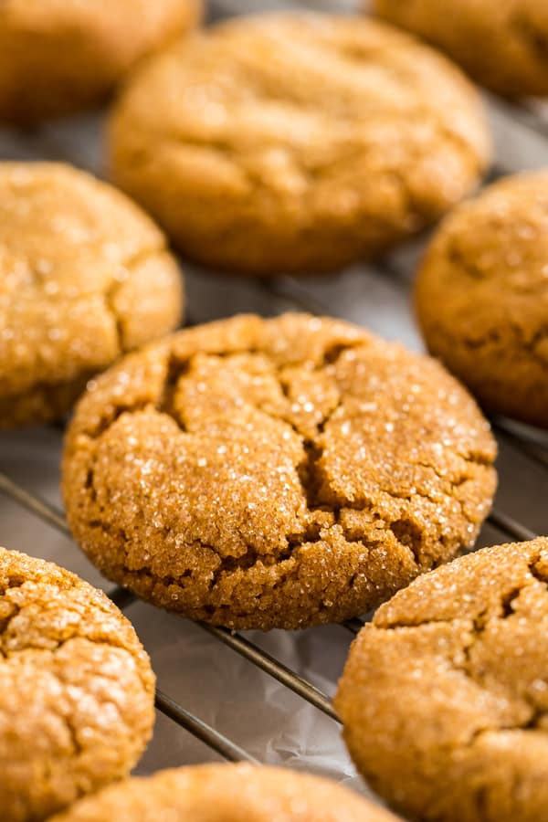 A close up of a molasses cookie on a cooling rack.