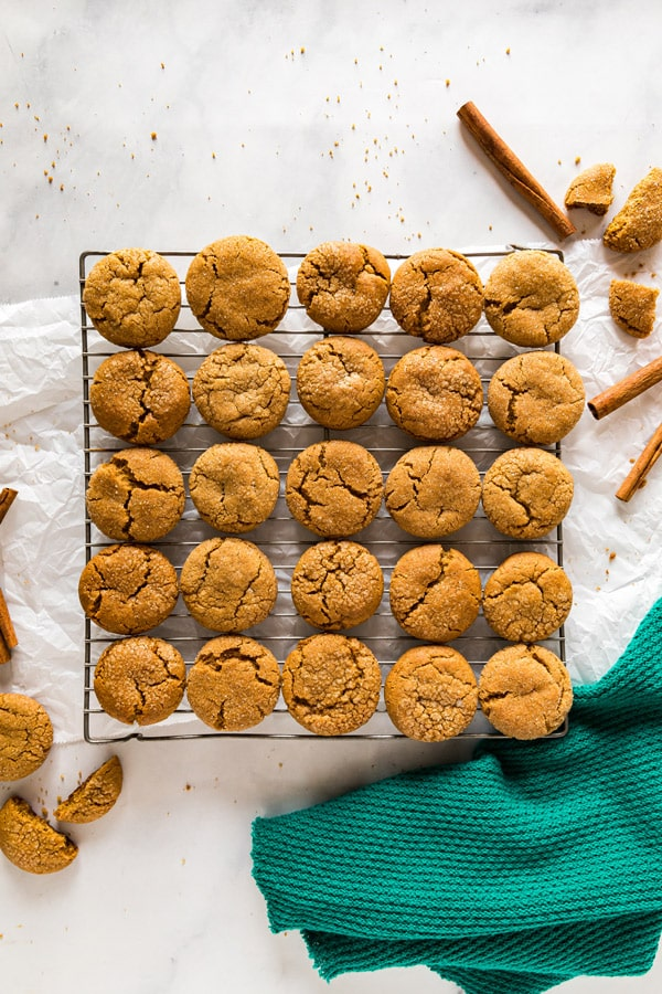 An overhead image of a cooling rack of molasses cookies