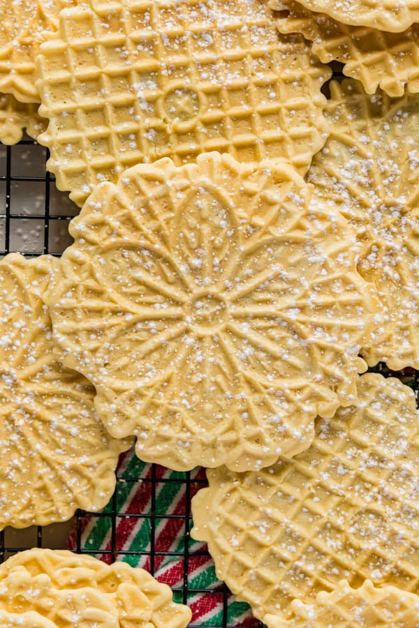 A close up overhead image of this pizzelle recipe stacked other pizelles