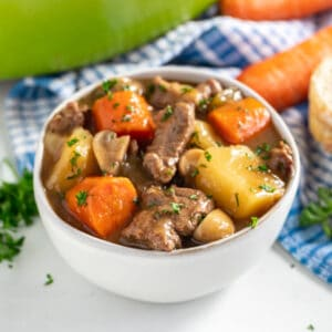 This Irish Guinness Lamb Stew is the most deliciously cozy dinner! It's an easy recipe that includes fall-apart-tender chunks of lamb meat, plenty of vegetables and a flavorful gravy that's so good you'll want to sop up every last drop with a piece of crusty bread! This can also be made in the crockpot or instant pot!
