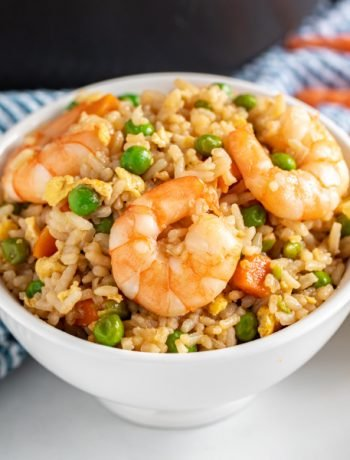 Shrimp Fried Rice is a quick and easy weeknight dinner option. This delicious Chinese-inspired stir fry recipe is a great, healthy way to repurpose leftover rice and is so simple, it'll quickly become a staple in your recipe rotation.