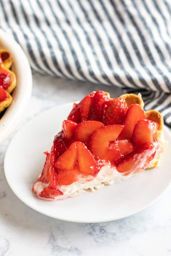 A slice of Strawberry Cream Pie on a plate.