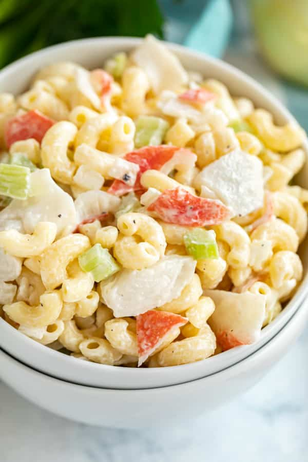 A close of up crab macaroni salad in a bowl.