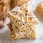 Cinnamon Toast Crunch Bars: an easy, homemade, no-bake dessert. If two of your favorite desserts, Rice Krispy Treats and Snickerdoodle Cookies had a baby, these would be it. Made with marshmallows, cinnamon sugar cereal, and butter, they're an ooey-gooey, crispy snack that's great to bring to a party!