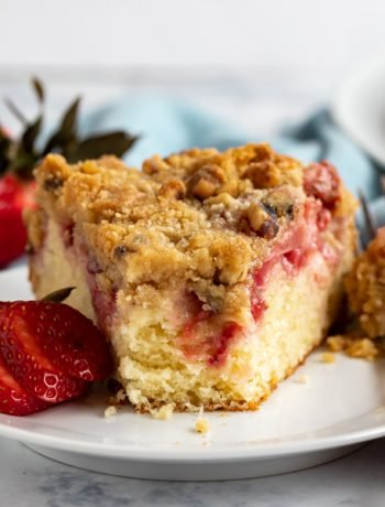 This homemade Fresh Strawberry Cake Recipe is the ultimate way to use all those fantastic strawberries that are currently in season. It's very easy to make from scratch and comes out delicious every single time with tons of delicious strawberries and a crumb topping that can't be beat!