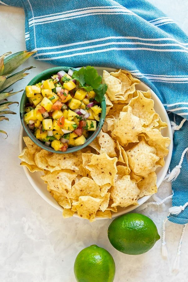 An overhead image of pineapple salsa and chips.