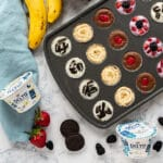 These frozen Greek Yogurt Bites are a seriously fun and easy snack and a cool treat for both kids and adults. I'll show you how to make these 4 different ways with a variety of flavors like blueberry, cookies and cream, peanut butter banana and chocolate cherry!