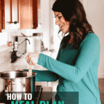 "Image of a happy woman cooking at a stove that says ""How to meal plan the smart way"""