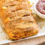This Crescent Roll Pizza Braid is the perfect appetizer to bring to a gathering or game day party! This easy recipe comes together quickly with a tasty crust and you can add whatever fillings you'd prefer.