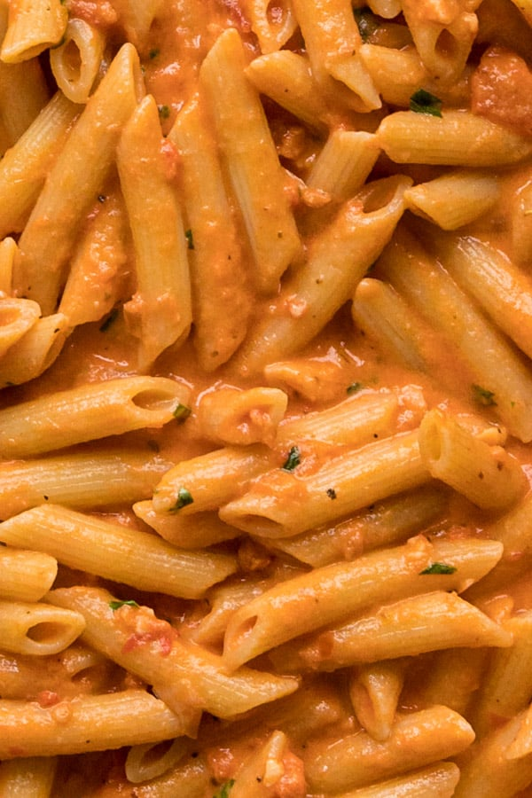 An overhead image close up of penne alla vodka sauce.