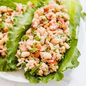 Lettuce leaves with Italian tuna salad on them.