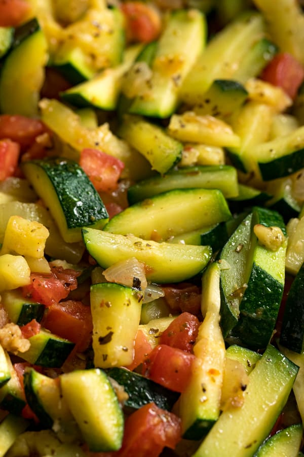 A close up overhead image of Sautéed Zucchini and Tomatoes